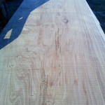 Try to find the faces in this Macrocarpa lumber.