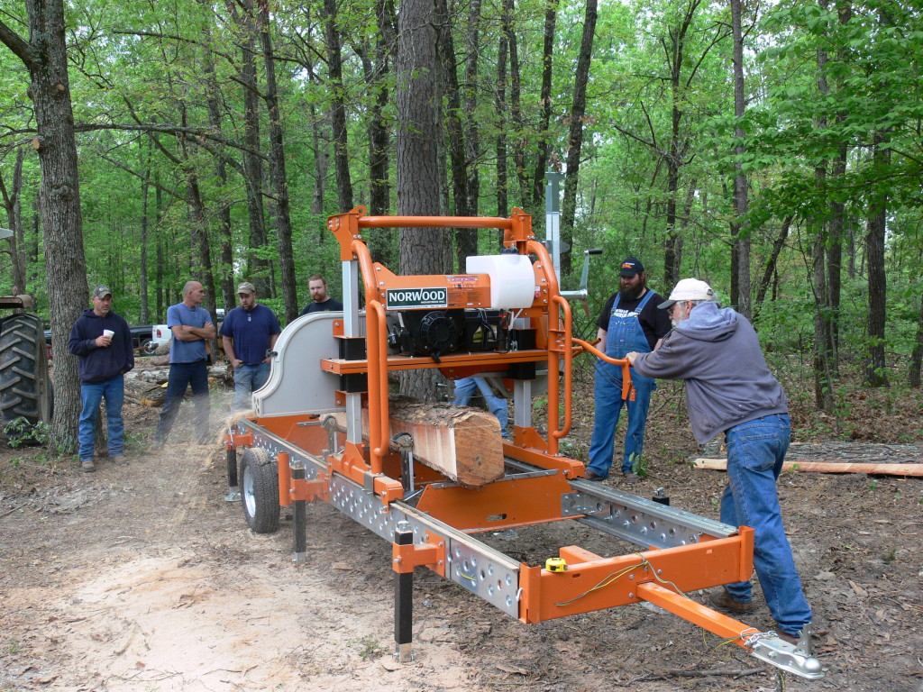 Demonstrating a Norwood portable sawmill