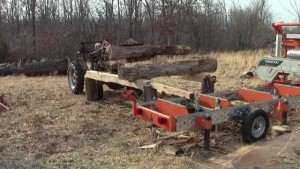 Log deck front end loader portable sawmill