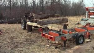 Log deck front end loader portable sawmill